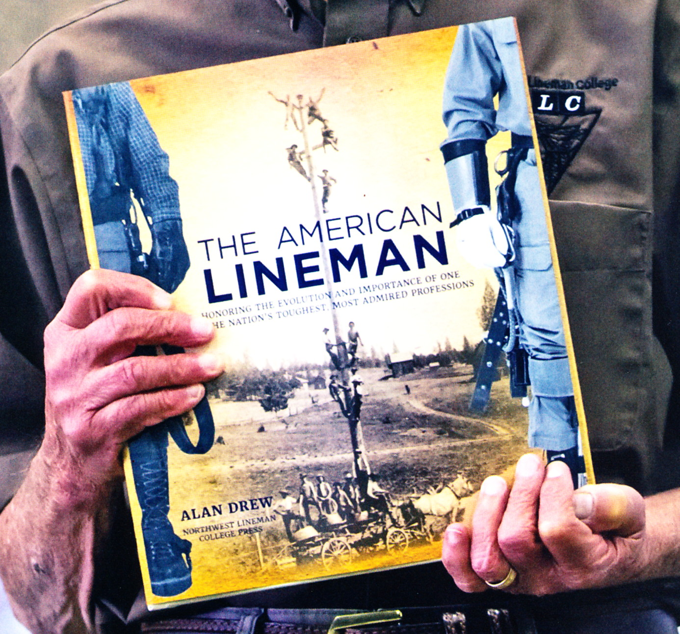 Alan Drew Holding His Book