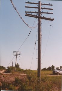 Railroad relics. This 1997 view of neglected, but surviving open wire terminal structure, reminds us of what we owe technically to the bygone age of aerial wire.